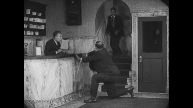 1921 Thwarted man (Buster Keaton) runs around hotel trying to escape tall angry man