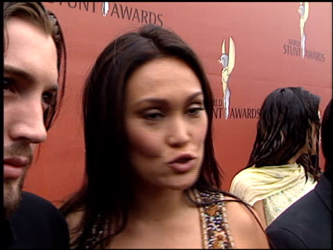 stockvideo's en b-roll-footage met tia carrere at the world stunt awards at barker hanger in santa monica, california on may 20, 2001. - tia carrere