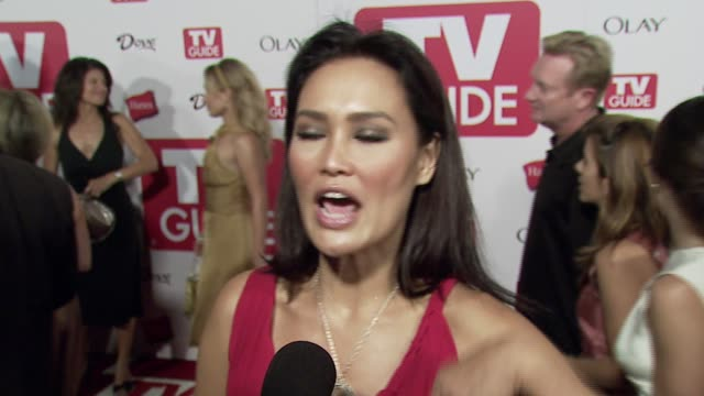vídeos de stock, filmes e b-roll de tia carrere on why shes at the party her reaction to the emmys and her disappointment that lost was not nominated and her favorite tv shows her... - tia carrere