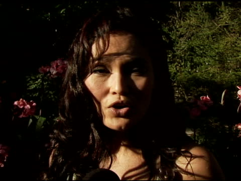vídeos de stock, filmes e b-roll de tia carrere on why she's in attendance her love of pets and her stint on 'dancing with the stars' at the bow wow ciao benefit for 'much love' animal... - tia carrere