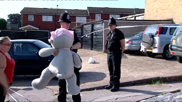 police question her grandmother and her grandmother's partner england london new addington ext woman leaving large soft toy as a tribute to murdrered... - itv weekend lunchtime news点の映像素材/bロール