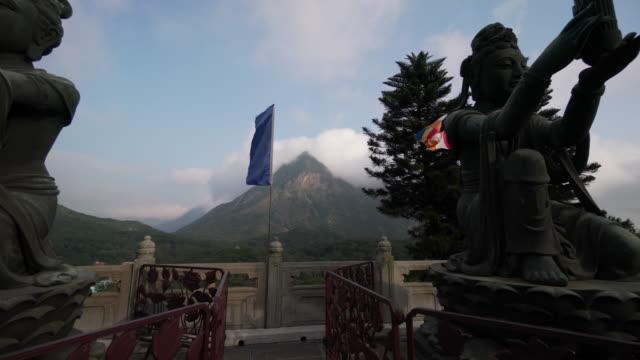 tian tan buddha in china mountains, trucking shot - tian tan buddha stock videos and b-roll footage