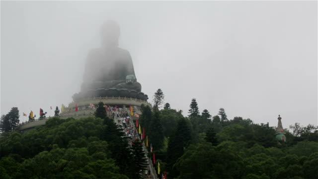 tian tan buddha on cloudy day, hong kong - tian tan buddha stock videos and b-roll footage