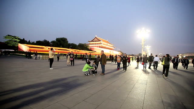 Beijing, China - October 17, 2016: Tiananmen gate at night with tourists.