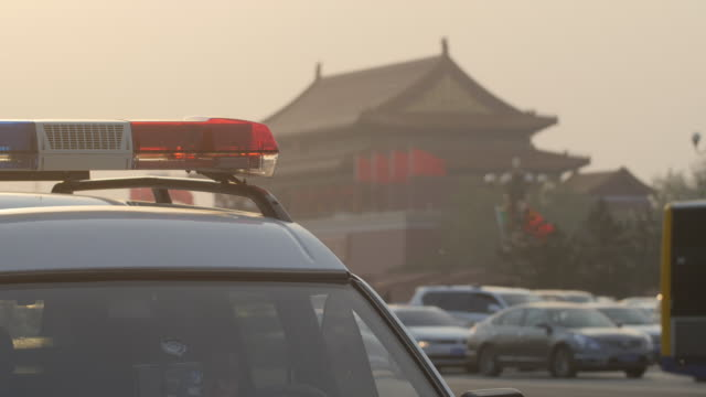 Tiananmen Square and Police Car with Light Bar Flashing