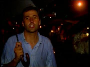 vidéos et rushes de tiananmen square anniversary:; c)een itn china: hong kong: ext at night i/c - place tien an men