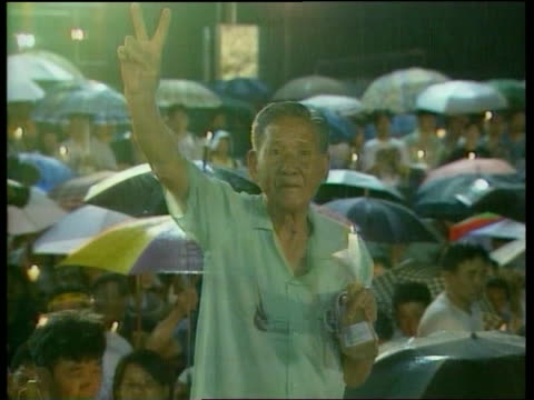 tiananmen square anniversary:; itn china: hong kong: at night tgv people gathered for candlelit vigil to mark anniversary woman with candle old man... - tiananmen square点の映像素材/bロール