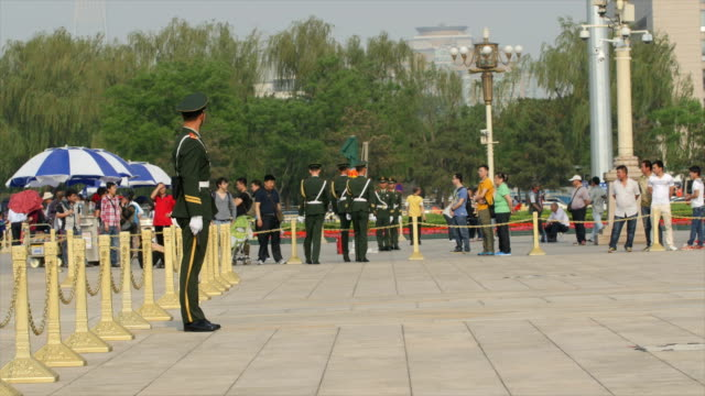 tiananmen square traffic and military police guarding national flag - mp stock videos & royalty-free footage