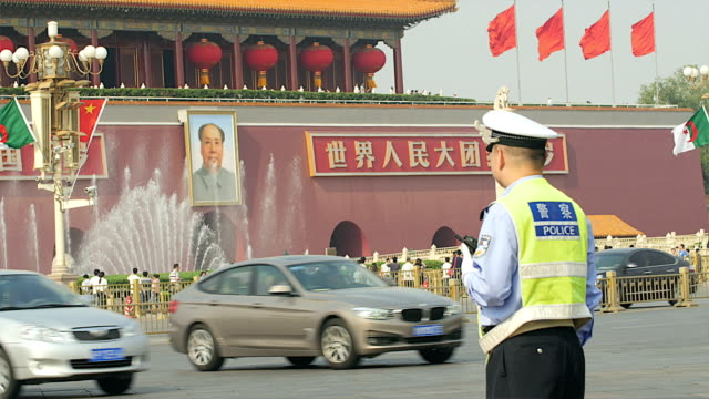 tiananmen square traffic, car bike and police - male likeness stock videos & royalty-free footage