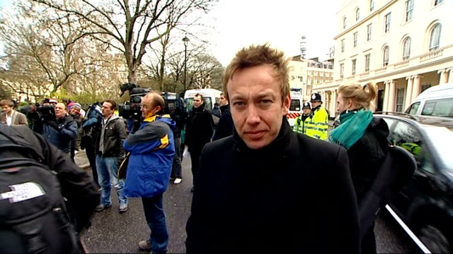 internet images of 'most wanted' released england london reporter to camera protibet demonstrators along with tibetan flags past chinese embassy... - digital camera stock videos and b-roll footage