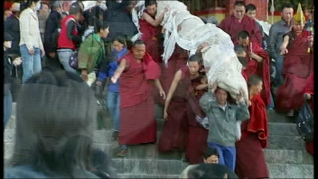government investment a threat to traditional lifestyle Lhasa Horns sounded from temple rooftop by Tibetan monks at Shoton Festival DAY Monks and...
