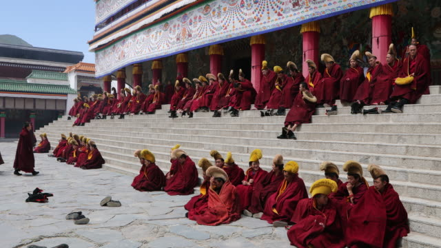 Tibet, Xiahe, Labrang Monastery, Tibetan Buddhist monks during a religious ceremony