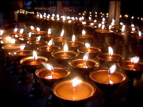tibetan buddhist butter candles - oil lamp stock videos & royalty-free footage
