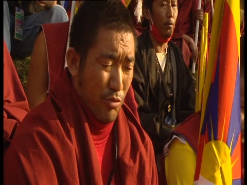 a tibetan monk chants during a ceremony - traditionally tibetan stock videos & royalty-free footage