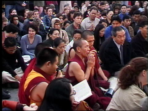 tibetan monks and others chant during spontaneous peace rally at union square / foot locker on 14th street in background aftermath of september 11th... - ニューヨーク 世界貿易センター点の映像素材/bロール