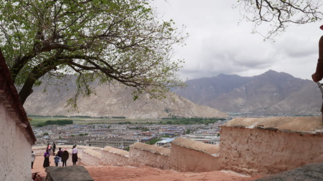 Tibetan people and tourist visit Potala palace in Lhasa, Tibet.