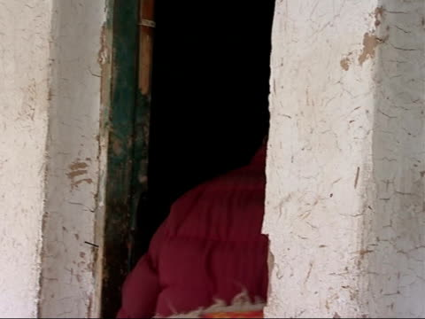xining region settlement / qinghai lake china qinghaitibetan plateau xining region ext tibetan women entering town wall gate / local residents along... - tea kettle stock videos & royalty-free footage