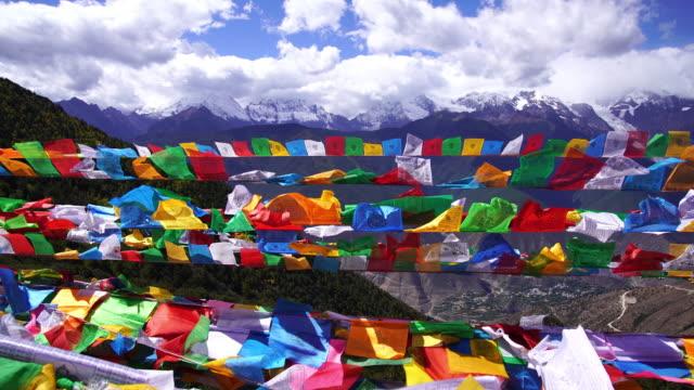 tibetan prayer flag or lung ta and kangchenjunga high mountain range view - pagoda stock videos & royalty-free footage