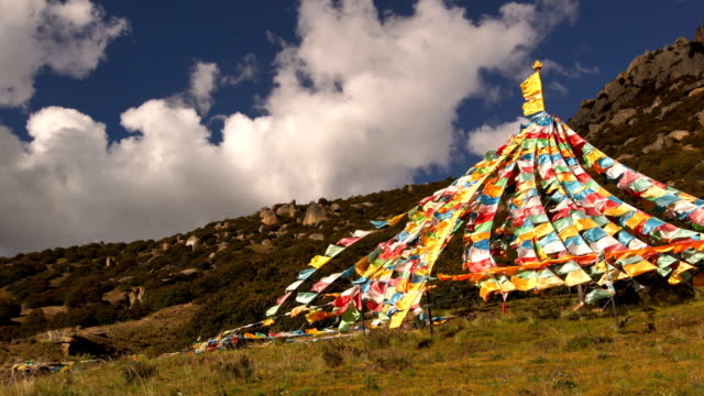 tibetan prayer flags at  lin zhi, china - tibet stock videos & royalty-free footage