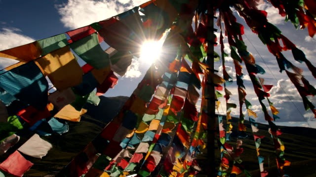 tibetan prayer flags at  lin zhi, china - flag stock videos & royalty-free footage