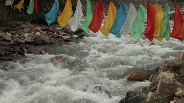 tibetan prayer-flags over whitewater river in tibet - traditionally tibetan stock videos & royalty-free footage
