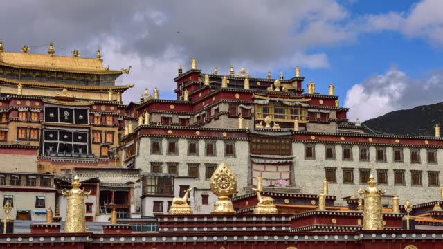 tibetan temple songzanlin monastery in shangri-la town of yunnan, china - nepal stock videos & royalty-free footage