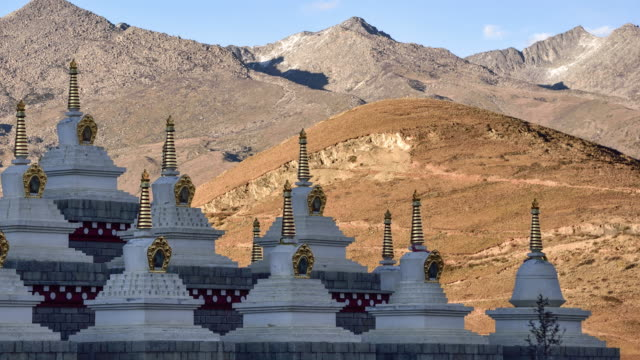 tibetan white pagodas in daocheng, sichuan province, china. - lamasery stock videos and b-roll footage