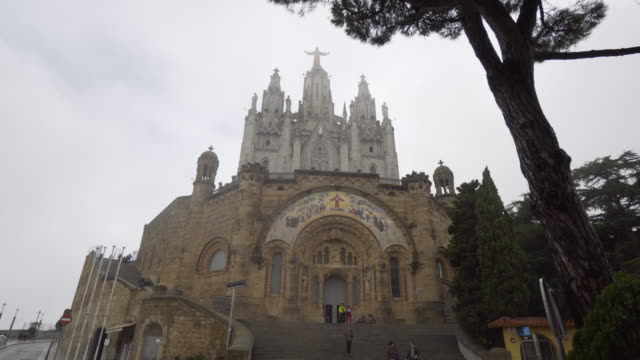 tibidabo under the rain. - cathedral stock videos & royalty-free footage