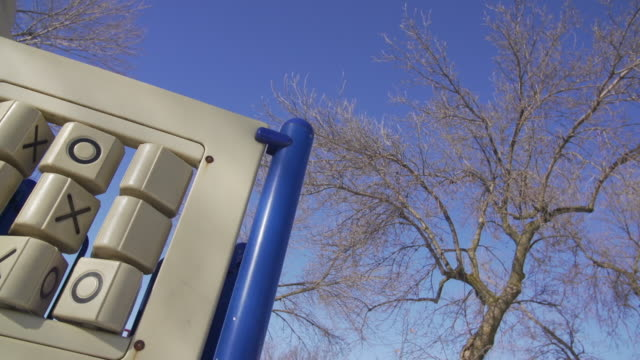 vídeos de stock e filmes b-roll de tic tac toe game in empty playground in winter - jogo do galo