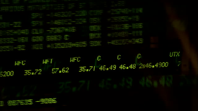 a ticker board displays stock data. available in hd. - kurstafel stock-videos und b-roll-filmmaterial