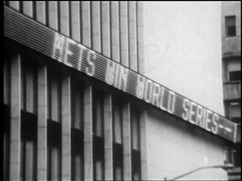 B/W 1969 ticker board reading Mets Win World Series / NYC / newsreel