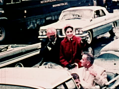 vídeos y material grabado en eventos de stock de ticker tape parades in washington dc and new york city for john glenn / john glenn his wife annie and lyndon johnson ride in convertible and wave to... - 1962