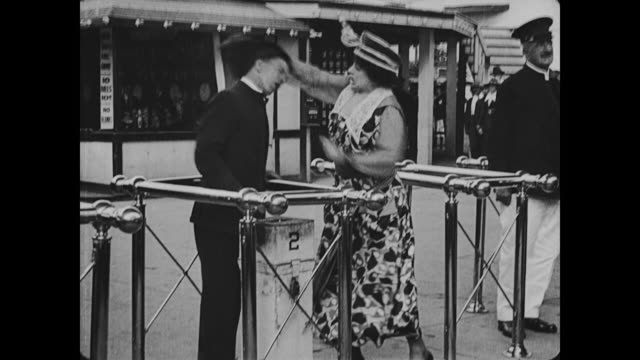 1917 ticket clerk asks indignant woman for ticket before she hits him on the head, knocking him down - ticket stock videos & royalty-free footage