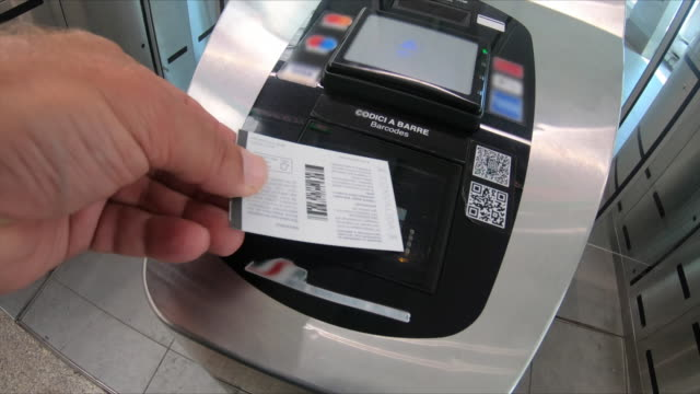 a ticket scanner at the train station in rome, italy, europe. - ticket stock videos & royalty-free footage