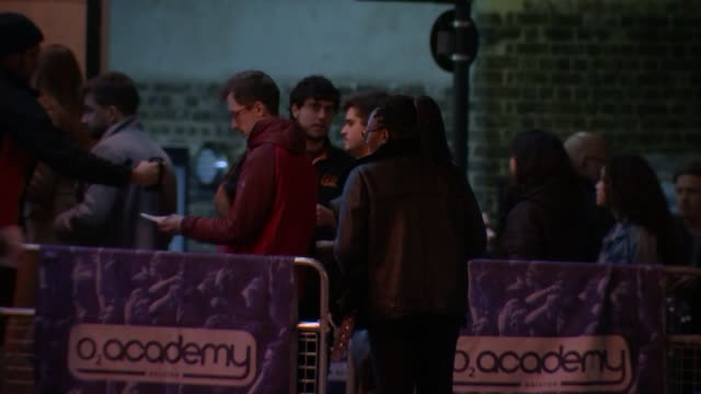 ticket touts face unlimited fines over crackdown on resale websites; england: london: ext / night people queuing outside the o2 academy to see band... - ticket stock videos & royalty-free footage