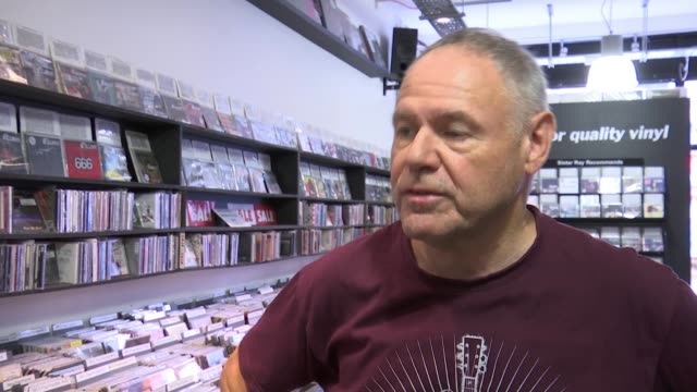 Ticketmaster to close two secondary resale websites ENGLAND London Soho EXT Sign outside record store 'Sister Ray' INT Various of man looking at CDs...