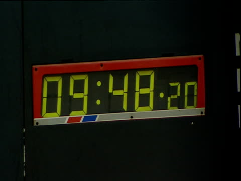 ticking digital clock on english railway station platform - 2000s style stock videos & royalty-free footage
