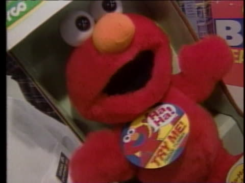 tickle me elmo doll in store there is an opening closeup shot of an elmo doll in a box next to a packaged snake light in a red shopping cart there is... - tickling stock videos & royalty-free footage