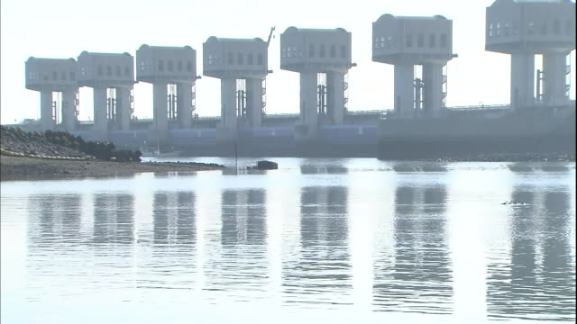tidal gates reflect on water surface in isahaya bay - polder stock videos and b-roll footage
