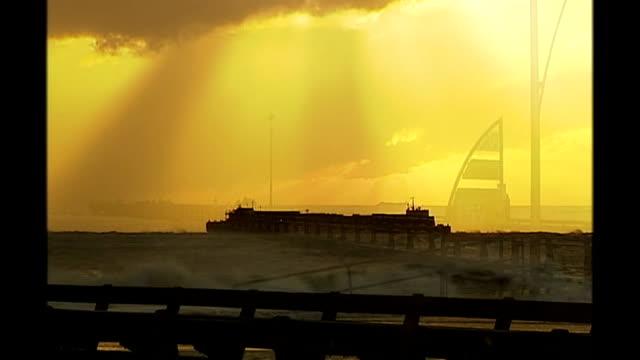 tidal surge along east coast of england; england: suffolk: lowestoft: ext sun rising revealing pier and raised sea levels caused by tidal surge along... - ローストフト点の映像素材/bロール