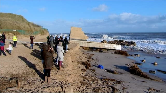 tidal surge hits east coast of uk bungalow collapsed down cliff face into sea with some of furniture still in original position people on beach... - ross sea stock videos & royalty-free footage