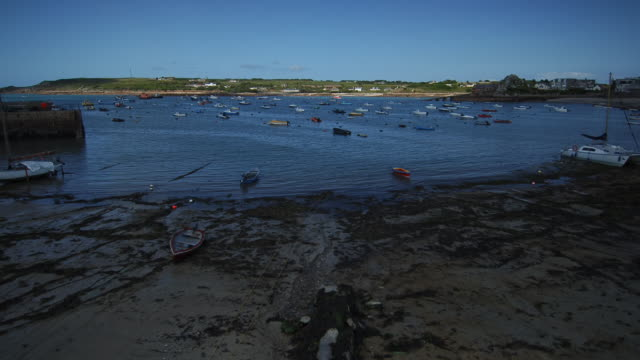 t/l tide coming in past moored boats, scilly isles, cornwall, united kingdom - isles of scilly stock videos & royalty-free footage