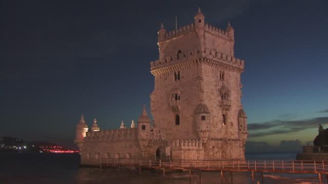 T/L LA WS Tide flowing past Torre de Belem at dusk / Lisbon, Portugal