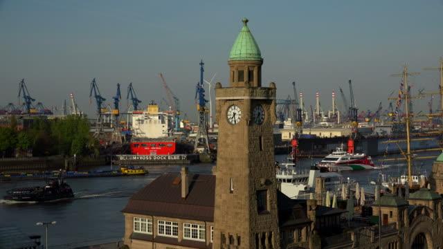 Tide Gauge Tower at St. Pauli Landing Stages with Floating Dock of Blohm & Voss Dockyard, Hamburg, Germany