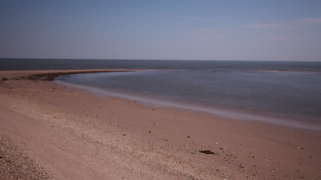 tl tide goes out on shallow beach, delaware, usa - tide out stock videos & royalty-free footage