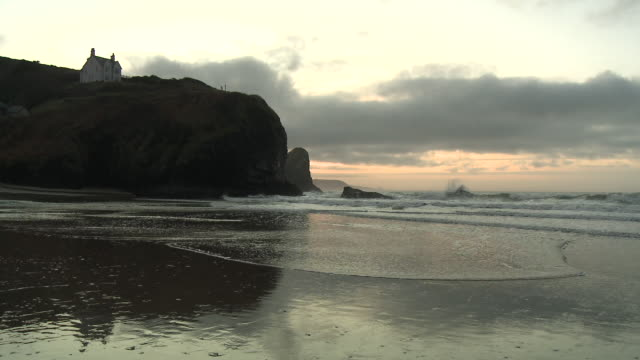 Tides coming in at Llangrannog beach, Wales, UK