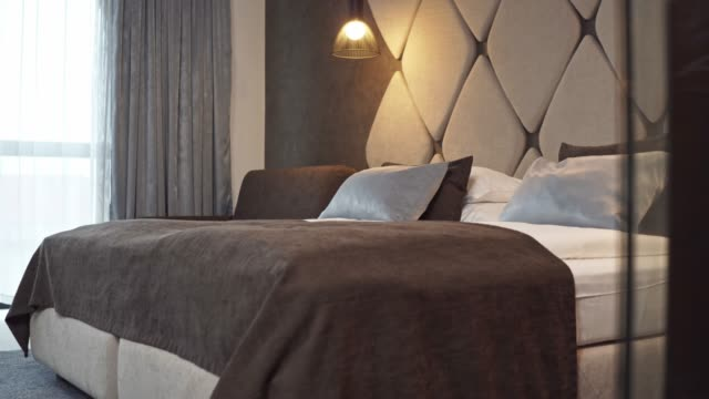 tidy bedroom in a modern business hotel - duvet stock videos & royalty-free footage