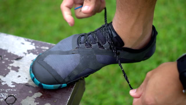 tie minimalist running shoe - tie stock videos and b-roll footage
