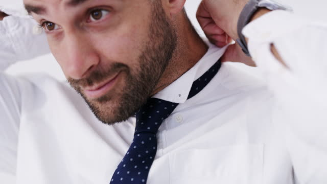 a tie will transform your look - shirt stock videos & royalty-free footage