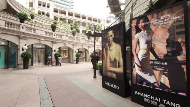 a tiffany co store stands on canton road in the tsim sha tsui area of hong kong china on monday may 16 shoppers stand in front of a tiffany co store... - tsim sha tsui stock videos & royalty-free footage